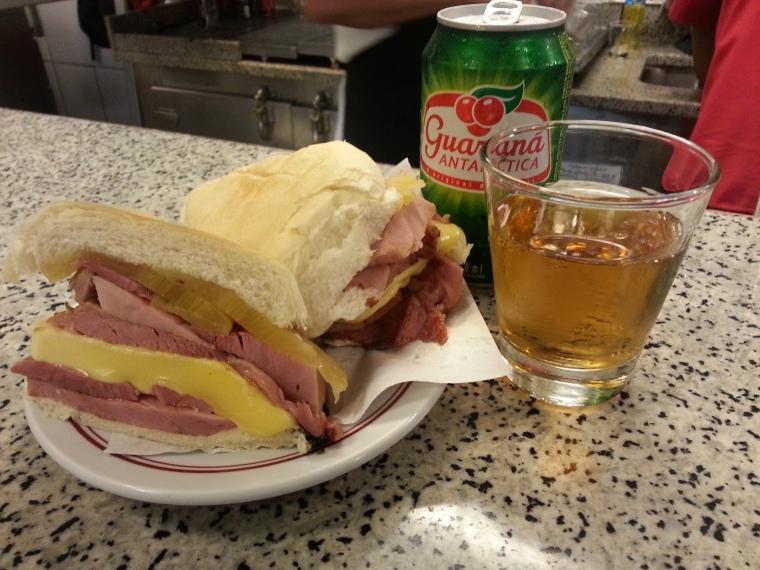 Honey ham, provolone and pineapple sandwich with guarana soda