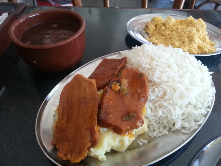 Sauteed beef tongue with mash, rice, beans, and farofa (fried cassava flour)